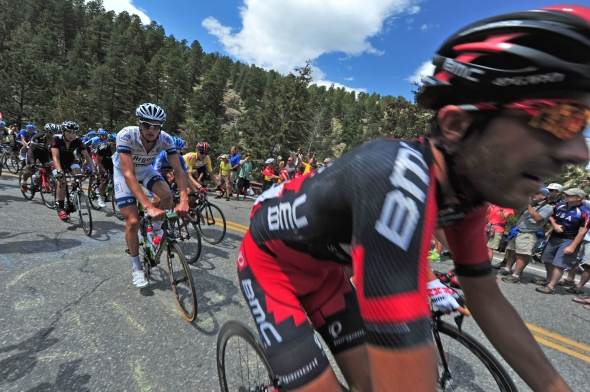 The Peloton buzzes around a switchback above Glen Haven on Saturday. The ability to get close to the riders drew around 700 fans to the last KOM climb outside of Estes Park.