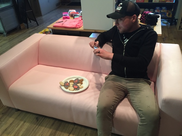 Stef sits on what has become his shop's trade mark pink couch. As his name implies, Tomasello is Italian, by heritage, and loves the iconic hue of the Giro d'Italia.