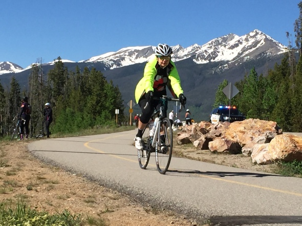 A rider rides the bike path over the Lake Dillon Dam.