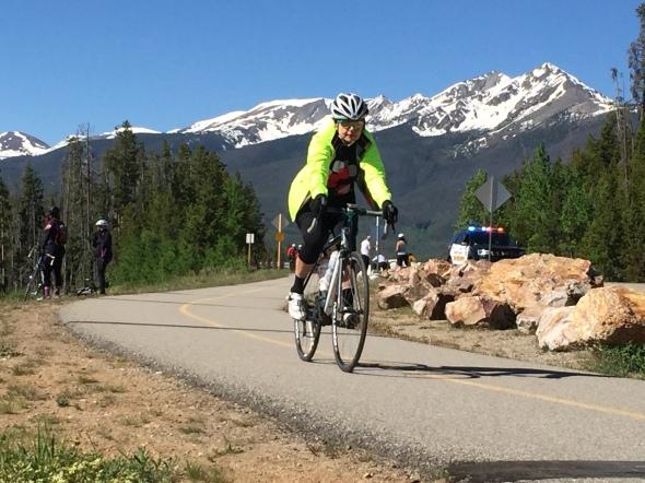 A rider rides the bike path over the Lake Dillon Dam.