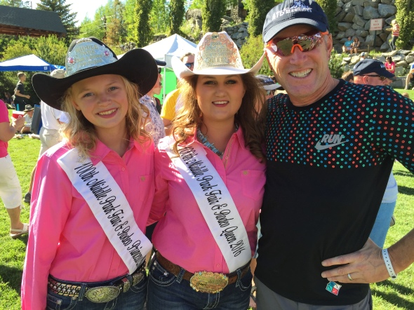 Donald Lewis enjoys attention from rodeo Queens in Grand Lake.