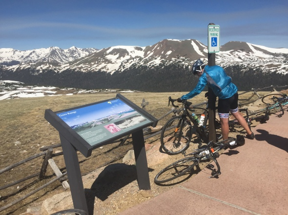 Rider stop briefly to recover from the long climb, but start up again quickly, due to high winds and chilly temperatures on Trail Ridge Road.